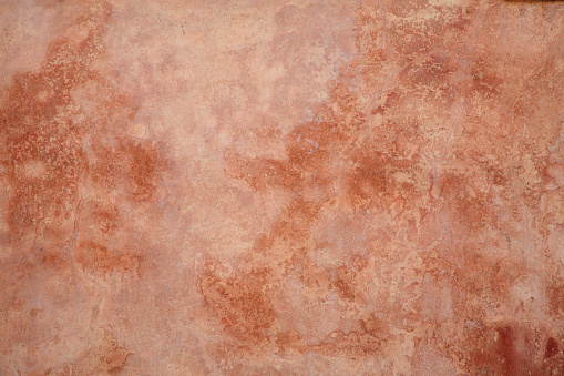 Colorful,textured, wall background with orange and brown coloring.  Great background.