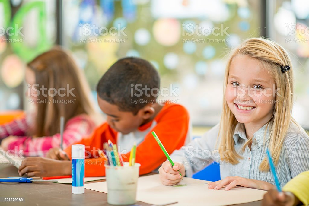 Coloring an Art Project in Class stock photo