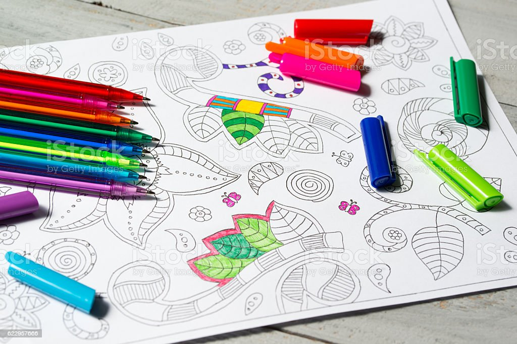Coloring book for adults with abstract patterns and colored pens stock photo
