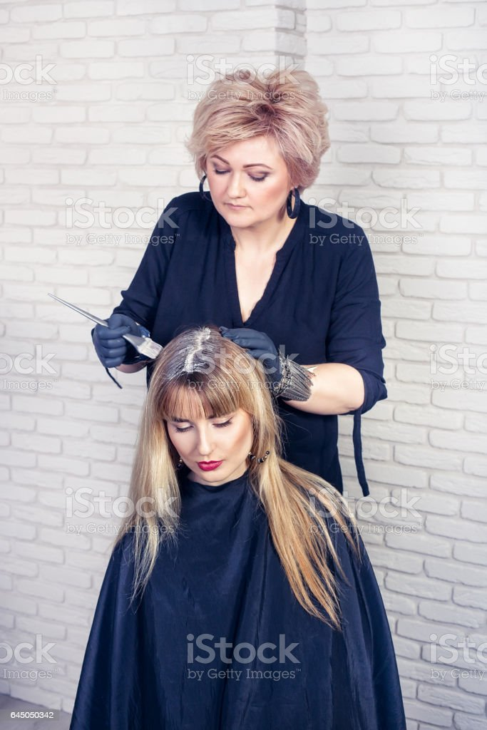 coloring female hair stock photo