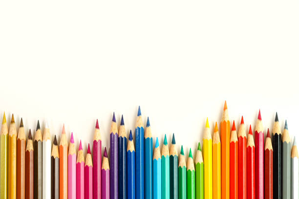 coloring pencils on row - coloured pencil stock photos and pictures