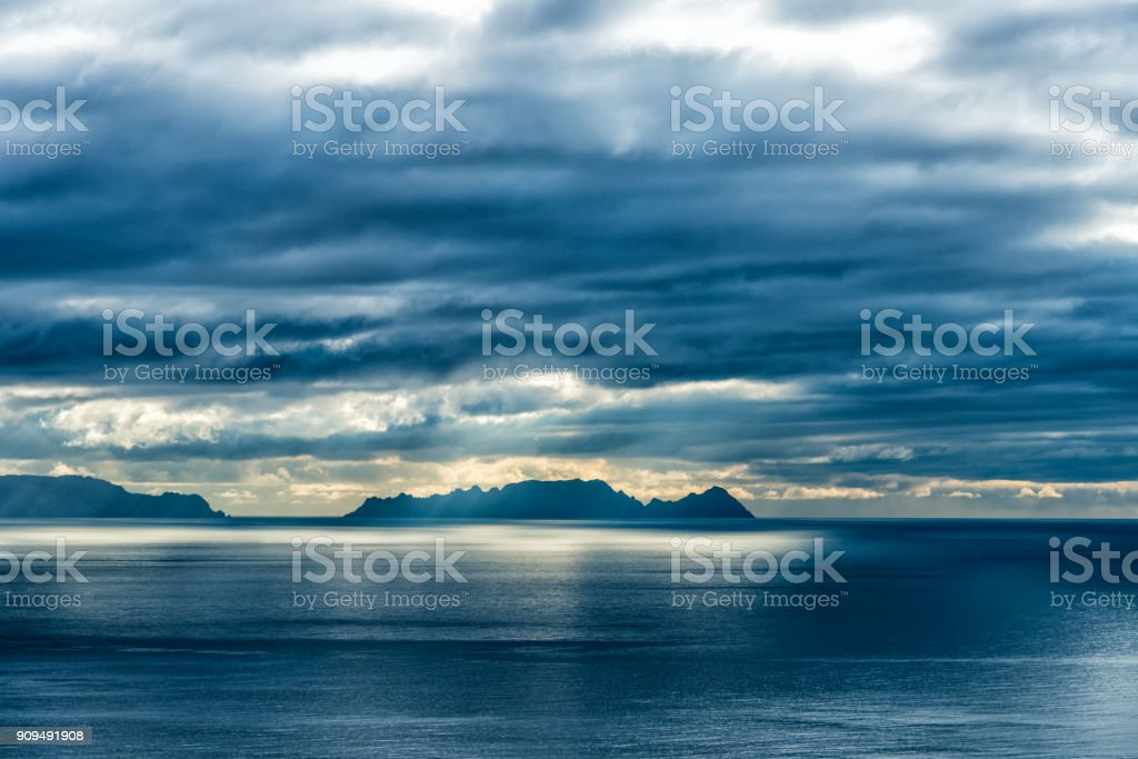 colors before the storm - island in ocean stock photo