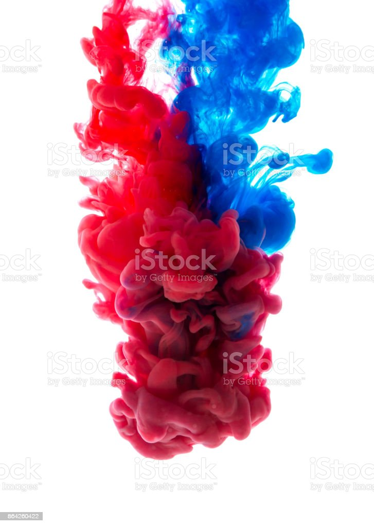 Colors dropped into liquid and photographed while in motion. Cloud of silky ink in water on white isolated background, an abstract banner. royalty-free stock photo