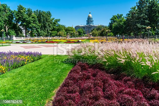 Denver , Colorado - Colors gardens in front of Colorado State capitol green space during summer time blue sky sunny day