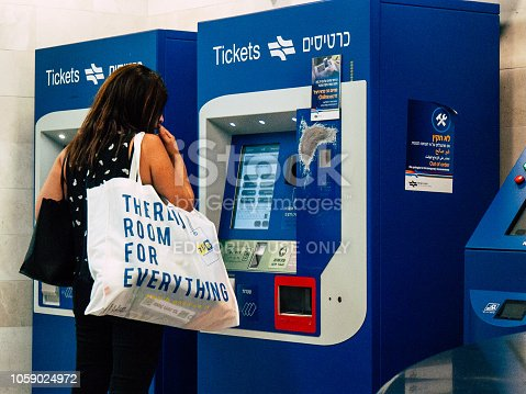 Tel Aviv Israel October 23, 2018  View of unknown Israeli people using the ticket machine in the local train station of Tel Aviv in the afternoon