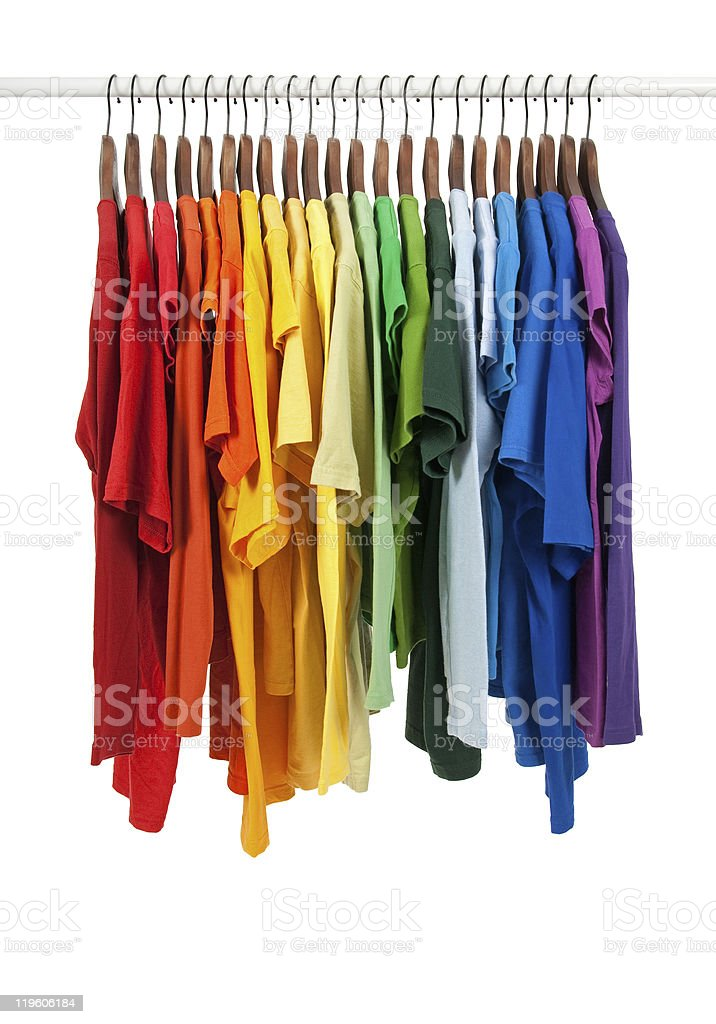 Colors of rainbow, shirts on wooden hangers royalty-free stock photo