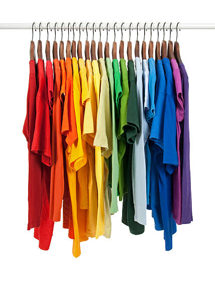 Colors of rainbow, shirts on wooden hangers stock photo