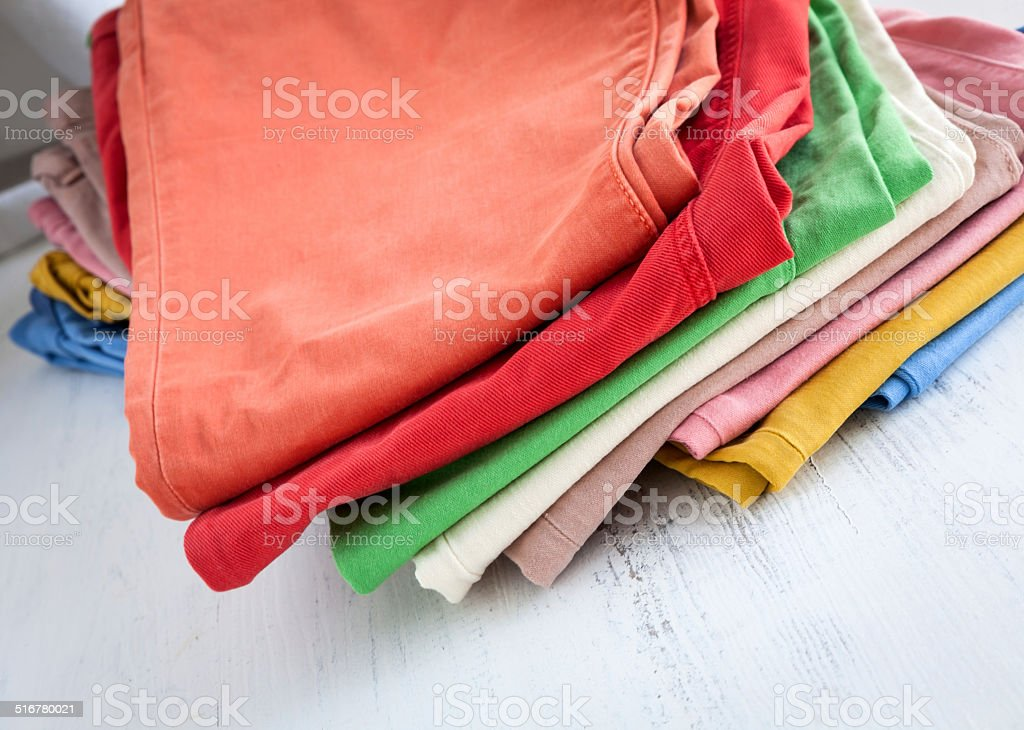 Colors pants on wooden table stock photo