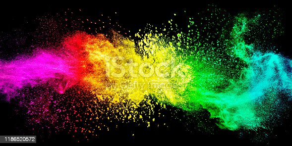 Abstract exploding colorful powder on black background.