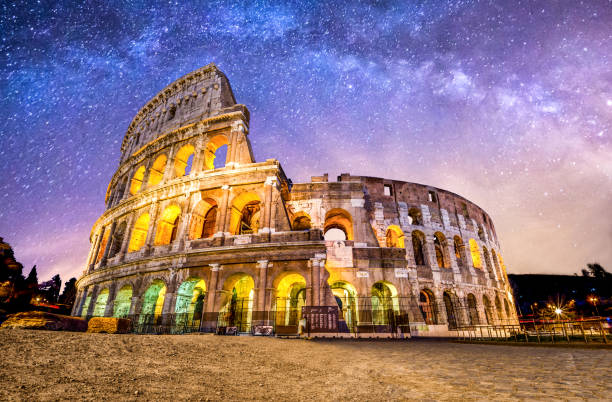 Colosseo roma coliseum colosseum rome no people exterior night milkyway front view of Coliseum of Rome at night with the milky way. Italy coliseum rome stock pictures, royalty-free photos & images