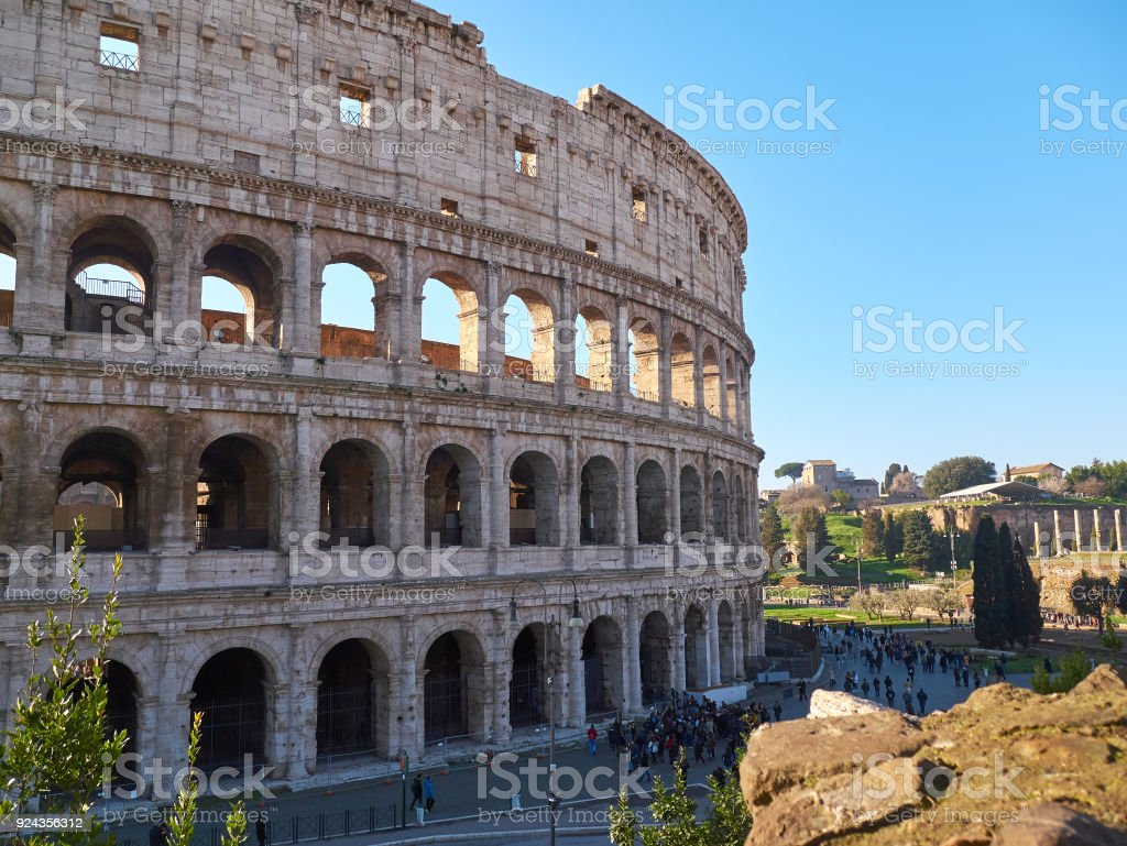 Colosseum, also known as the Flavian Amphitheatre with tourists in Rome, Italy stock photo