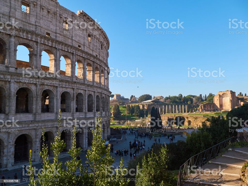 Colosseum, also known as the Flavian Amphitheatre with tourists. Rome, Italy stock photo