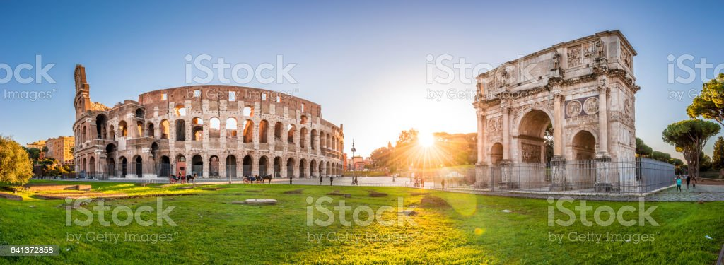 Colosseum and Constantine Arch at sunrise, Rome. Panorama stock photo