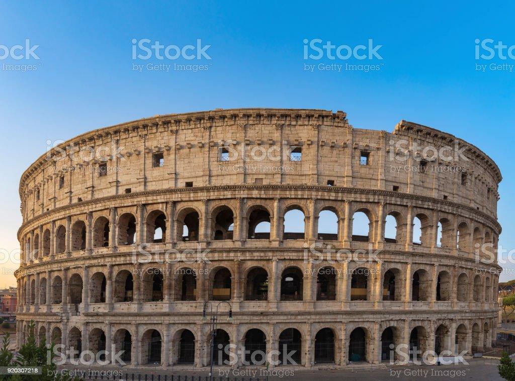 Colosseum at sunrise in Rome. stock photo