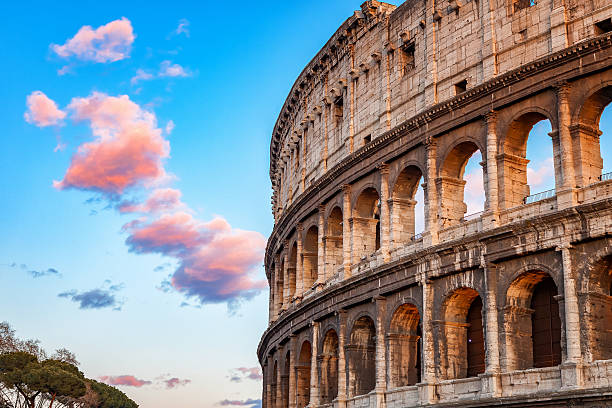 colosseum at sunset - italy stock photos and pictures