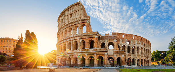 Colosseum in Rome and morning sun, Italy Panoramic view of Colosseum in Rome and morning sun, Italy, Europe. coliseum rome stock pictures, royalty-free photos & images