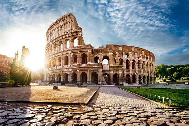 Colosseum in Rome and morning sun, Italy Colosseum in Rome and morning sun, Italy coliseum rome stock pictures, royalty-free photos & images