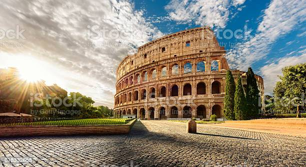 Colosseum in rome and morning sun italy picture id618332658?b=1&k=6&m=618332658&s=612x612&h=e08cmmz3cqhrihg 5ify9vnqvoz78uhn1rxvjjix8eq=