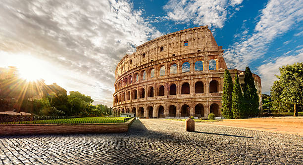 Colosseum in Rome and morning sun, Italy Colosseum in Rome and morning sun, Italy rome italy stock pictures, royalty-free photos & images