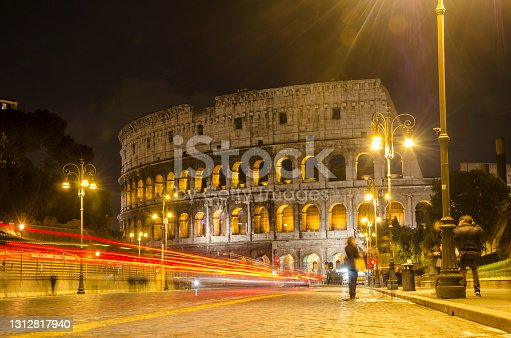 istock Colosseum in Rome in the evening with stripes of light 1312817940