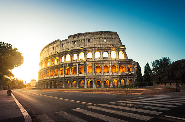 Colosseum in Rome, Italy at sunrise Colosseum in Rome in the light of rising sun. coliseum rome stock pictures, royalty-free photos & images