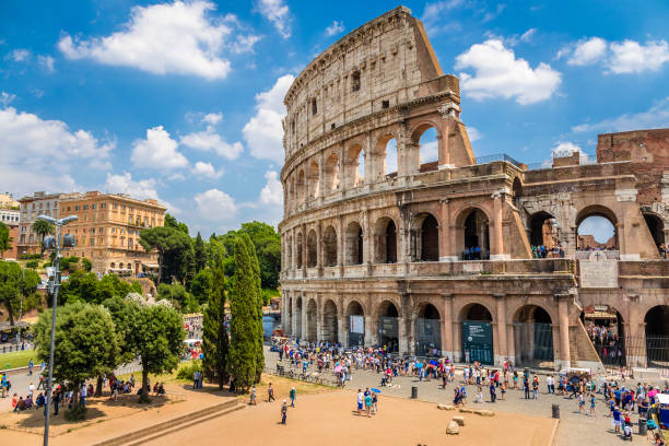 Colosseum with clear blue sky and clouds, Rome. Panorama Colosseum with clear blue sky and clouds, Rome. Panorama rome italy stock pictures, royalty-free photos & images