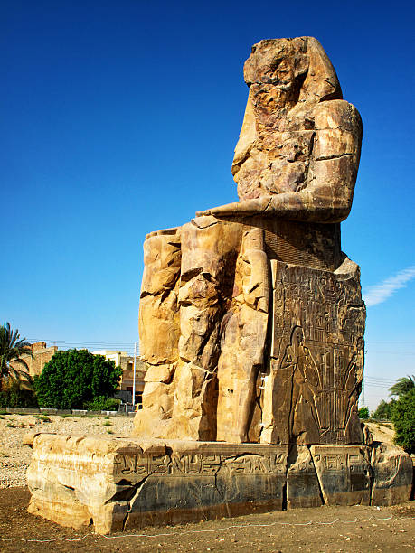 Colossi of Memnon Colossi of Memnon - the statues here are of pharaoh Amenhotep the 3rd and were constructed in 1350 BC. valley of the kings stock pictures, royalty-free photos & images
