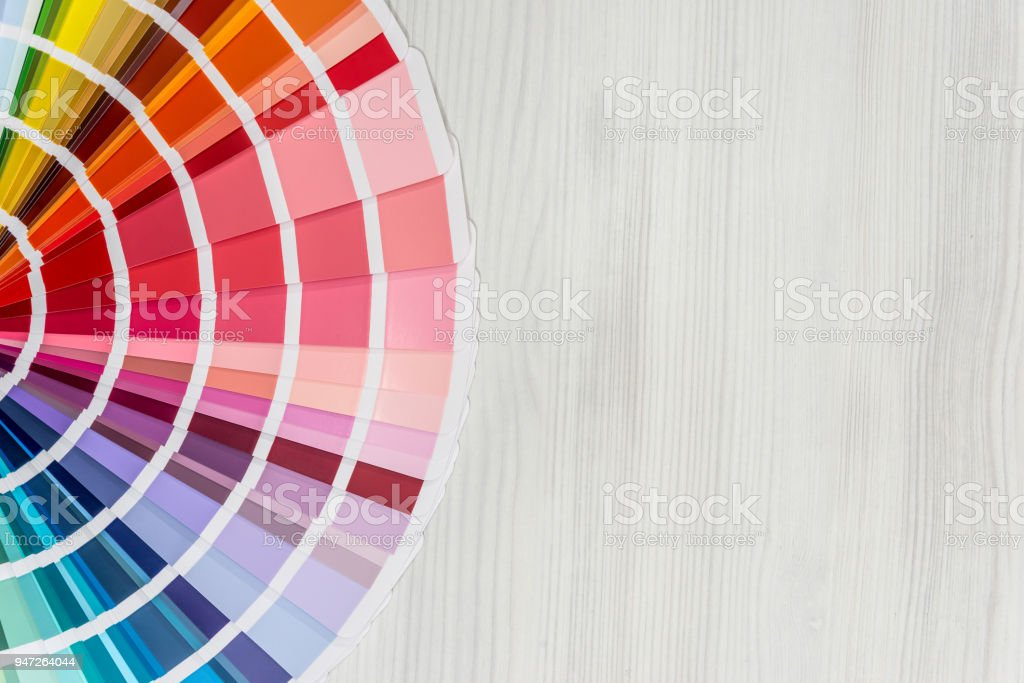 Colour guide on light wooden background, top view stock photo