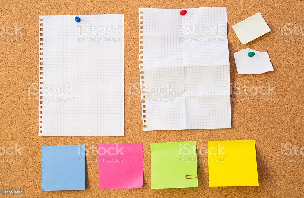 Colour note papers on pin board. Cork background royalty-free stock photo