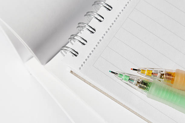 Colour pencils and books stock photo