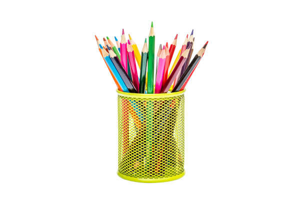 Colour pencils in metal pencil box. Isolated on white. stock photo