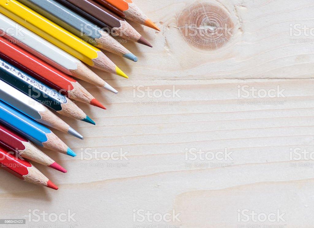 Colour pencils on wooden table Lizenzfreies stock-foto