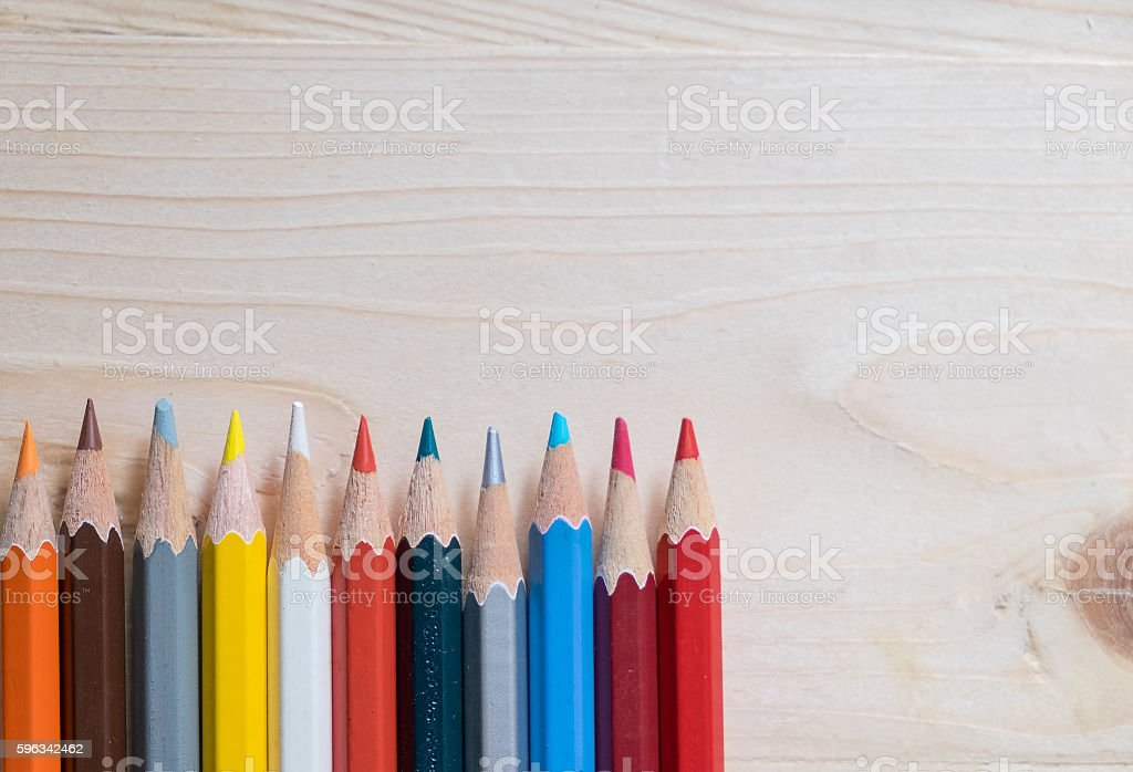Colour pencils on wooden table royalty-free stock photo