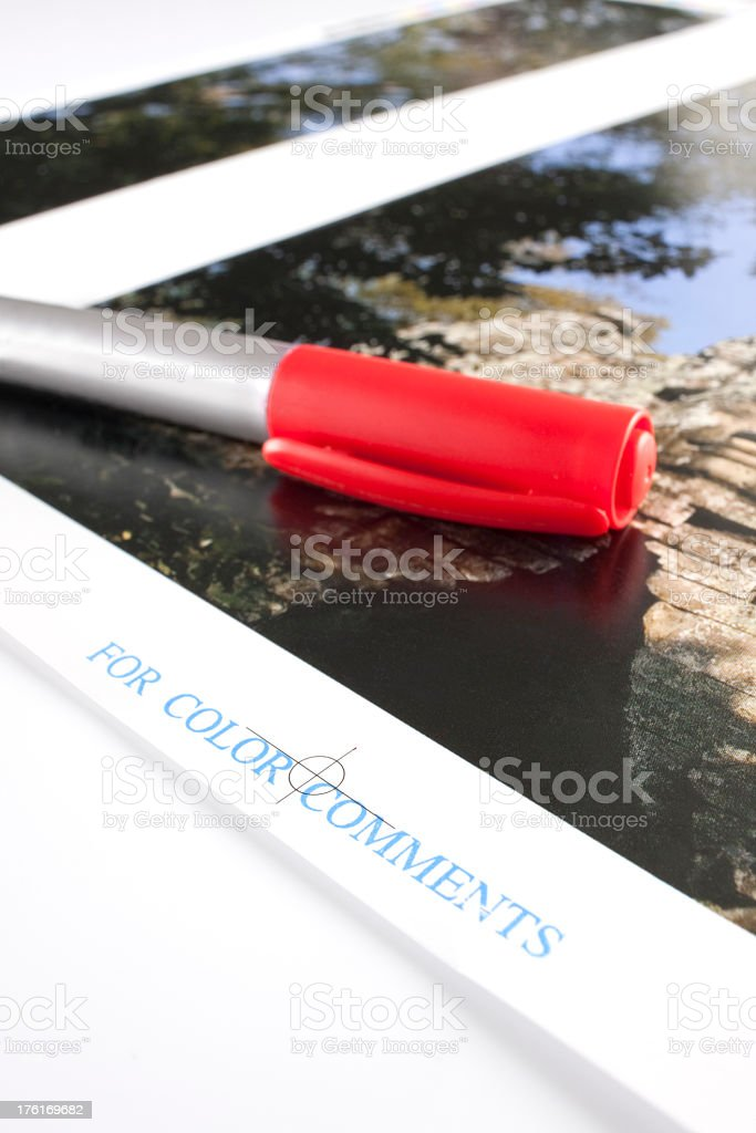 Colour proof and mark up pen ready to be corrected. stock photo