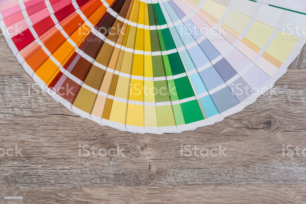 Colour samples decomposed in circle on wooden table stock photo