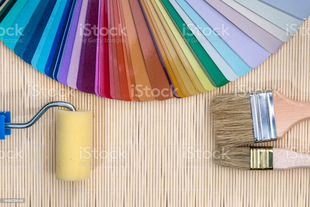 Colour samples with brushes on bamboo mat background stock photo