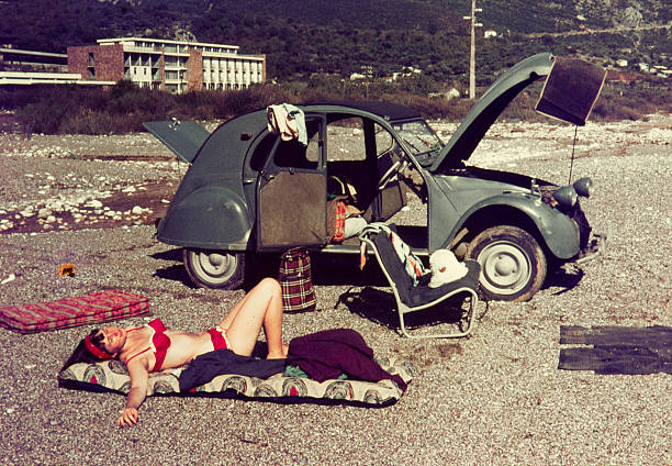 colour slide from 1960s, young woman relaxing with her car. - beach fashion stock photos and pictures