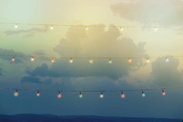 colour string lights with bokeh decor in outdoor party stock photo