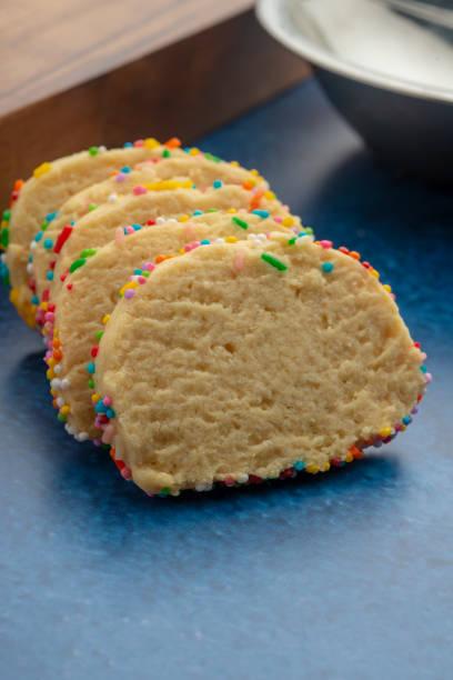 coloured biscuits in studio - fette biscottate foto e immagini stock