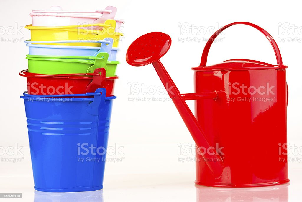 Coloured buckets and watering can royalty-free stock photo