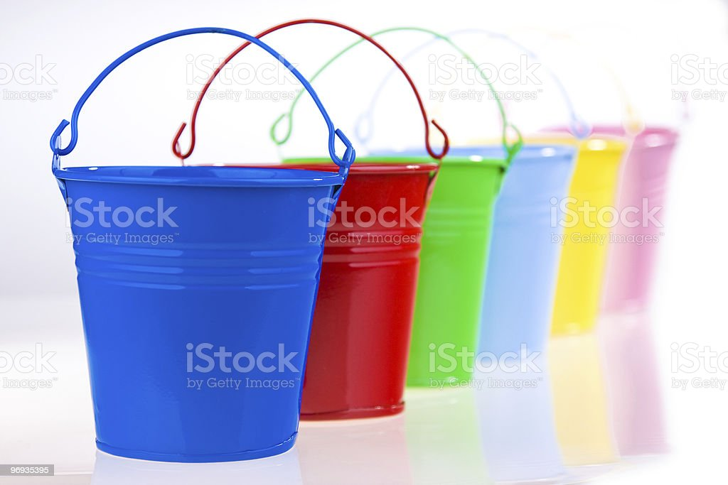 Coloured buckets in line royalty-free stock photo