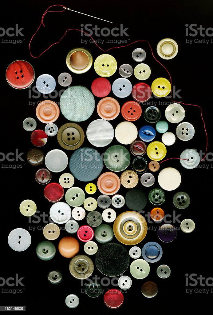 Coloured buttons with needle & thread royalty-free stock photo