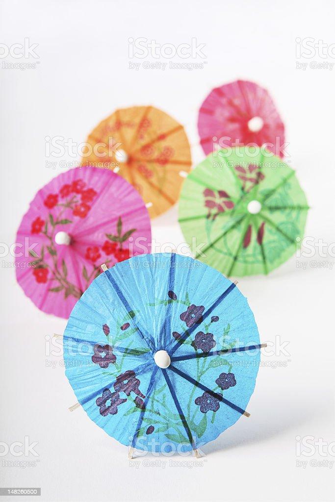 coloured cocktail umbrellas stock photo