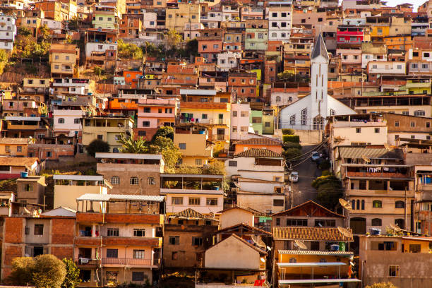 Coloured houses and church in a sloping city in Minas Gerais - Brazil stock photo