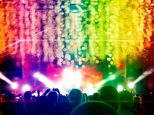 LGBT coloured party Rainbow coloured nightclub with people partying and dancing gay pride parade stock pictures, royalty-free photos & images