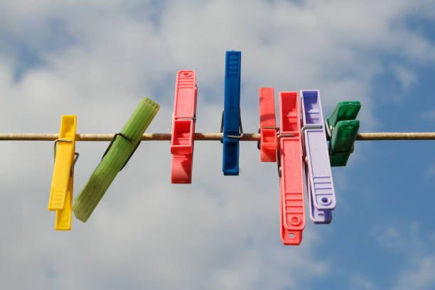 Coloured pegs on a washing line stock photo