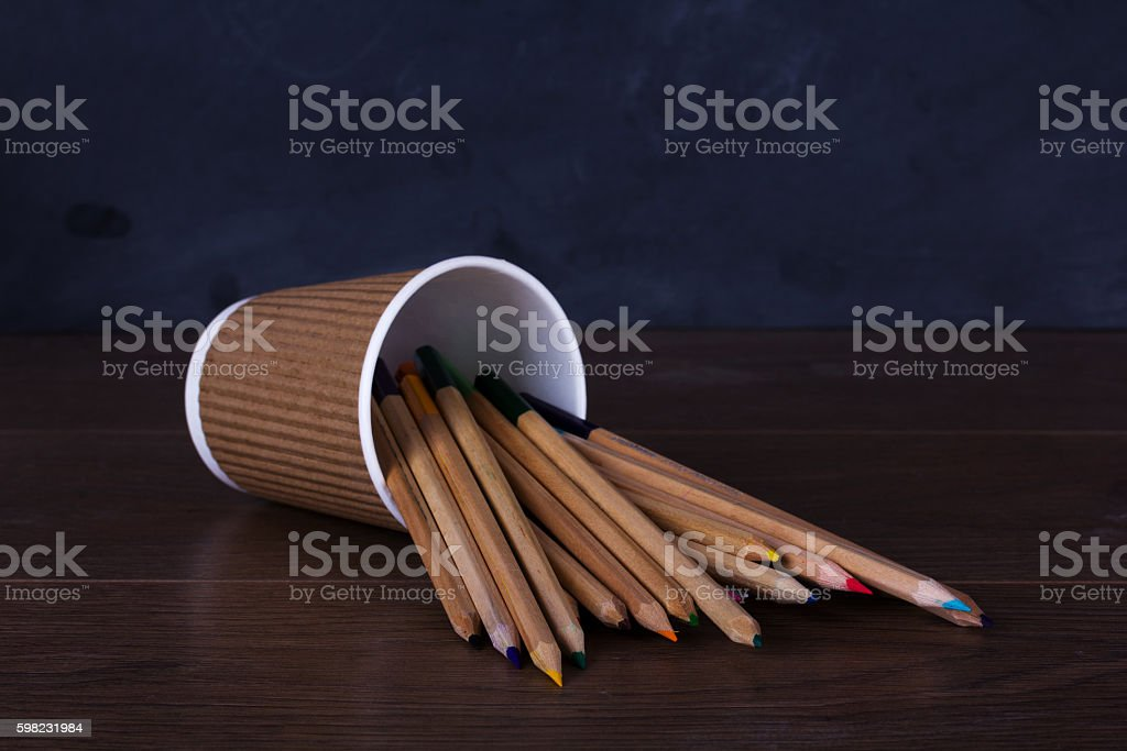 Coloured pencils on a worn black background foto royalty-free