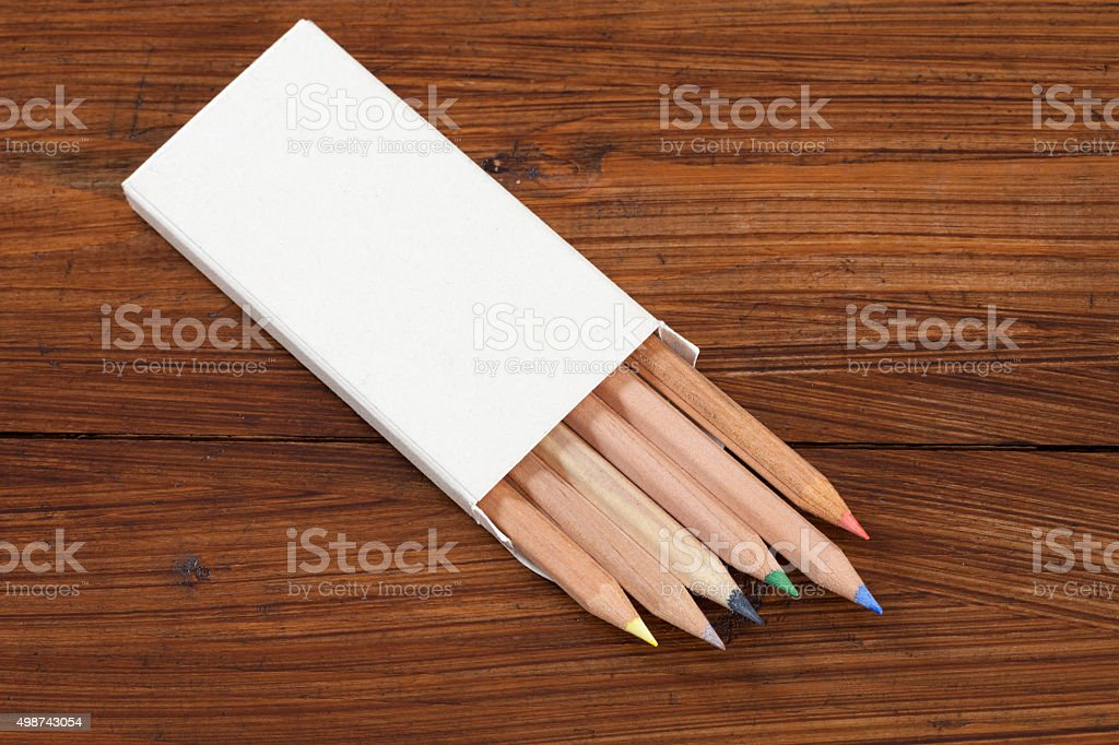 Coloured pencils on wood stock photo