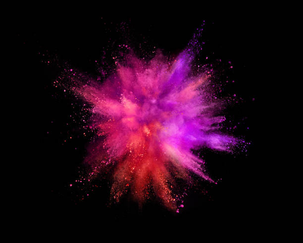 coloured powder explosion isolated on black background - magenta stock photos and pictures