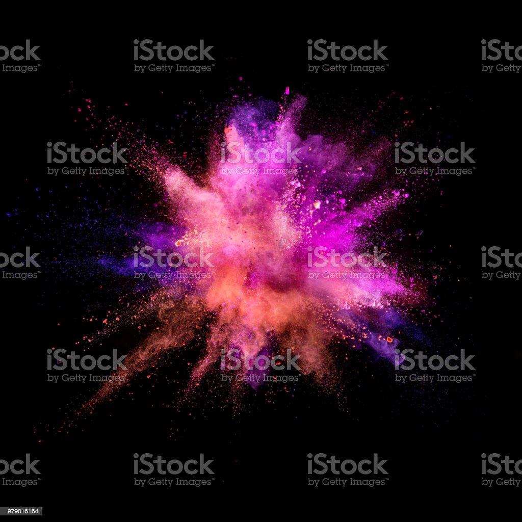 Coloured powder explosion on black background stock photo